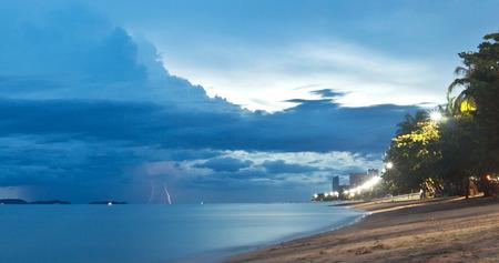 Sunset and lightning on Jomtien beach, Pattaya, Thailand Stock Photo