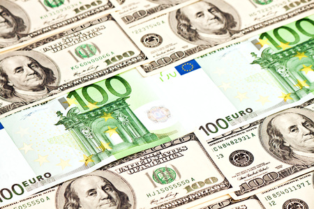 A heap of dollars and euro banknotes