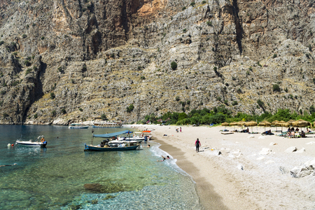 oludeniz: BUTTERFLY VALLEY BEACH, TURKEY - JUNE 01: Tourists visit famous Butterfly Valley beach near Oludeniz in Turkey on JUNE 01, 2016. Butterfly Valley  beach is one of the best beaches in Turkey Editorial
