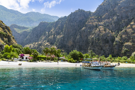 Tourists visit famous Butterfly Valley beach near Oludeniz in Turkey on JUNE 01, 2016. Butterfly Valley  beach is one of the best beaches in Turkey