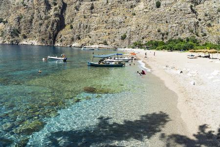 Tourists visit famous Butterfly Valley beach near Oludeniz in Turkey Stock Photo