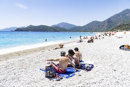 Tourists visit Oludeniz beach in Turkey