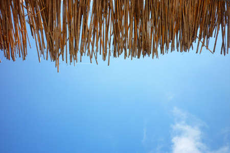 palapa: canopy of straw on the beach against the clear blue sky Stock Photo