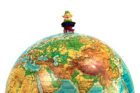 cartographer: Doll man playing an accordion on a globe