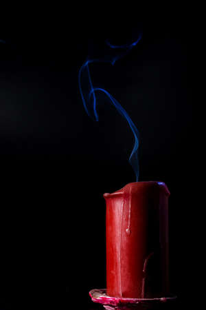 hope background: blue smoke flying upside from the extinct red candle