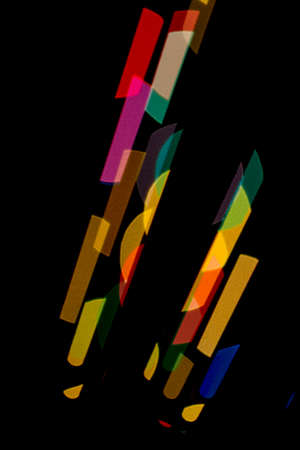 upright: Black background with colored shapes stand upright
