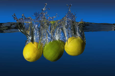 lime slice: tropical fruit limes and lemons dropped in water