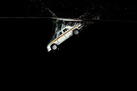 passenger car fell into the water holding up a lot of splashing night Stock Photo