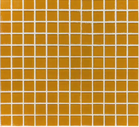 seamless tile: mosaic of small square glass tiles orange color Stock Photo