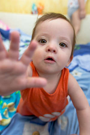 baby crawling: baby crawling on the bed and stretches forward