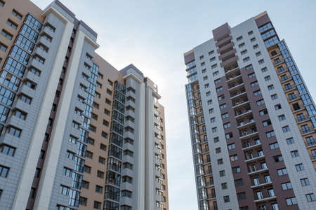 storey: multi-storey high-rise an apartment building on the sky background Stock Photo
