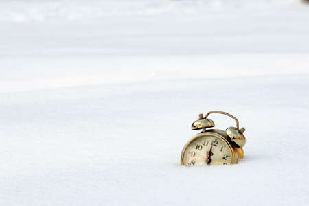 old clock in the pure white snow