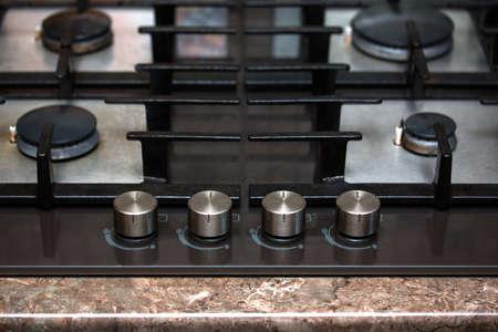 butane: modern gas stove burners and control knobs