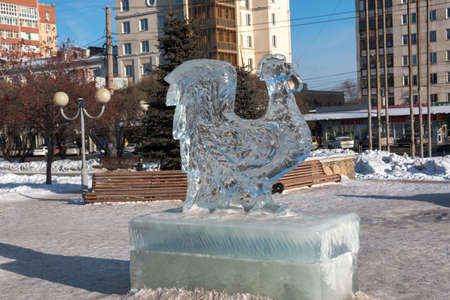 rooster sculpture made of ice in the recreational park