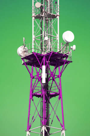 Cell tower with antenna in red and purple