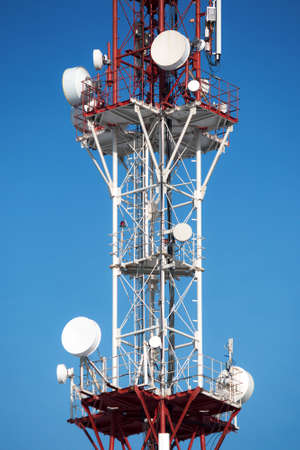 Cellular tower with antenna in red and white color Stock Photo