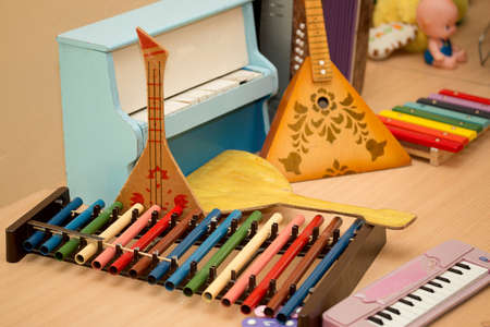 Antique antique toys musical instruments balalaika, accordion, harpsichord, piano