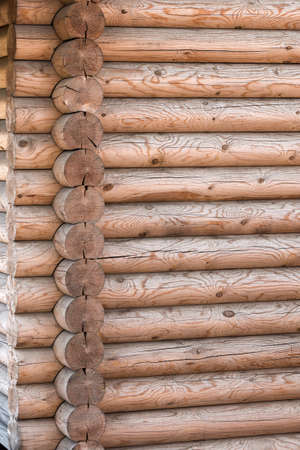calibrated: Wooden house from calibrated logs of brown color