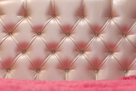 Classic upholstery pink of the headboard, sofa, chair, wall Stock Photo