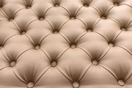 Classic upholstery of the headboard, sofa, chair, wall