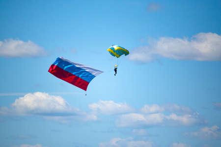 parachute jump: jump parashutist with the flag of Russia  Stock Photo