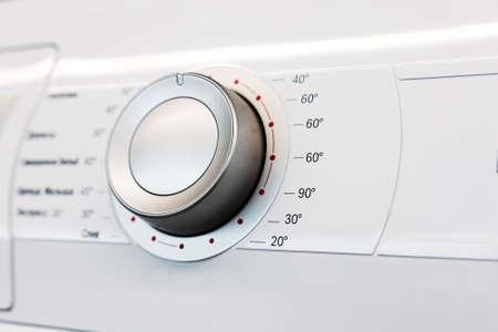 Regler auf dem Bedienfeld von Haushaltsgeräten. Details für den Werbedesigner Standard-Bild