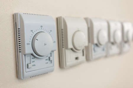 high-tech regulators to control household appliances are located on the wall of the room Foto de archivo - 109351473