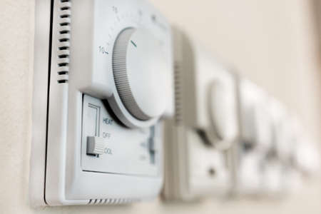 high-tech regulators to control household appliances are located on the wall of the room Foto de archivo - 109338249