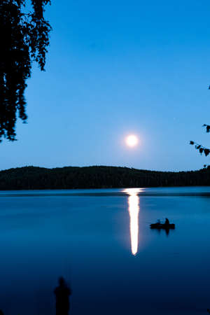 fantastic night landscape with moon over summer lake Imagens