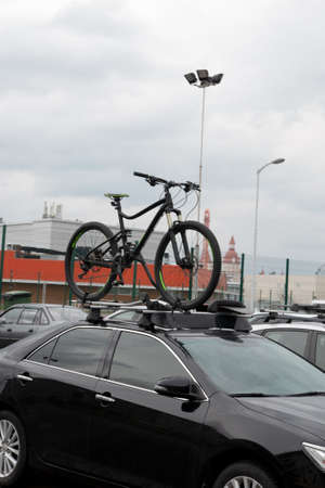 mountain bike fixed on the roof of a car.