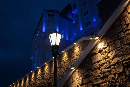 Lantern near a tall antique stone wall Standard-Bild - 140188997