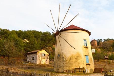 Windmill from Cubuk Lake, Turkey Stock Photo