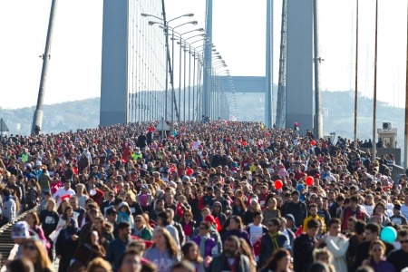 People are crossing the Bosphorus Bridge from Asia to Europe during 35th Istanbul Eurasia Marathon Fun Run on November 17, 2013 in Istanbul, Turkey