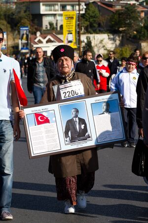 koprusu: Woman hold Ataturk poster during 35th Istanbul Eurasia Marathon Fun Run on November 17, 2013 in Istanbul, Turkey
