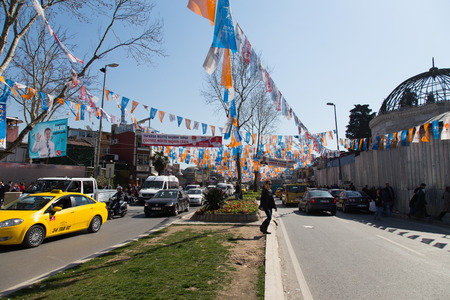 elector: ISTANBUL - MARCH 22: Streets covered with flags and banners before local elections in Turkey on March 22, 2014 in Istanbul, Turkey. Local elections will hold with more than 52m electors on 30 March Editorial