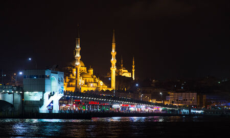 koprusu: ISTANBUL, TURKEY - FEBRUARY 23, 2014: People have fun at cafes and restaurant on Galata Bridge. Galata Bridge is one of the famous entertainment place in Istanbul.