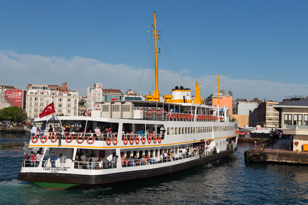 eminonu: ISTANBUL, TURKEY - MAY 17, 2014: Sehir Hatlari ferry in Kadikoy to Eminonu ferry port. Sehir Hatlari was established in 1844 and now carry 150,000 passengers a day