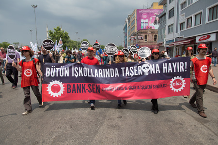 ISTANBUL, TURKEY - MAY 25, 2014: Unions march in protest against subcontractors in Turkey. No to subcontractors in all sectors write on banner.