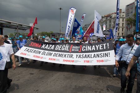 ISTANBUL, TURKEY - MAY 25, 2014: Unions march in protest against subcontractors in Turkey. Soma is murder not an accident write on banner