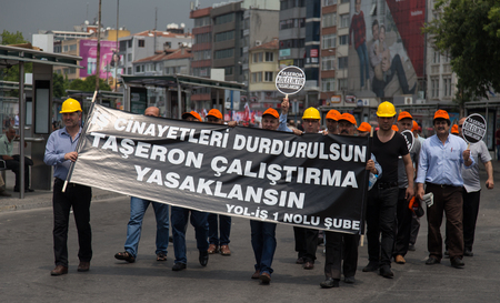 ISTANBUL, TURKEY - MAY 25, 2014: Unions march in protest against subcontractors in Turkey. Work killings stop and subcontracting ban write on banner