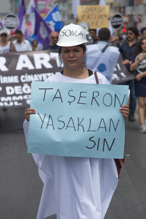 ISTANBUL, TURKEY - MAY 25, 2014: Unions march in protest against subcontractors in Turkey. Subcontracting ban write on banner