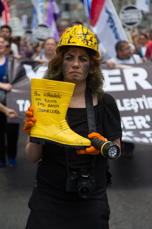 ISTANBUL, TURKEY - MAY 25, 2014: Unions march in protest against subcontractors in Turkey. Most clean thing is your boot write on boat