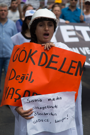 subcontractors: ISTANBUL, TURKEY - MAY 25, 2014: Unions march in protest against subcontractors in Turkey. Im one of the dead in Soma mine disaster write on banner Editorial
