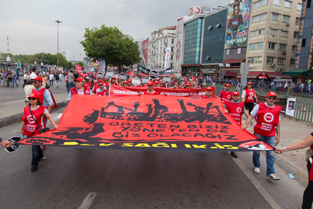 subcontractors: ISTANBUL, TURKEY - MAY 25, 2014: Unions march in protest against subcontractors in Turkey. We are producer and we will manage write on banner