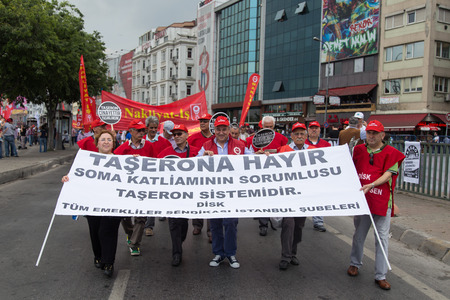 subcontractors: ISTANBUL, TURKEY - MAY 25, 2014: Unions march in protest against subcontractors in Turkey. No to subcontracting write on banner