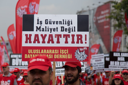 subcontractors: ISTANBUL, TURKEY - MAY 25, 2014: Unions march in protest against subcontractors in Turkey. Job security is not cost lives write on banner