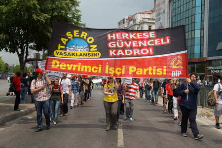 subcontractors: ISTANBUL, TURKEY - MAY 25, 2014: Unions march in protest against subcontractors in Turkey. Subcontracting ban write on banner