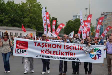 ISTANBUL, TURKEY - MAY 25, 2014: Unions march in protest against subcontractors in Turkey. Vontract labor is slavery write on banner