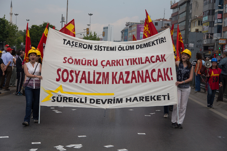 subcontractors: ISTANBUL, TURKEY - MAY 25, 2014: Unions march in protest against subcontractors in Turkey. Socialism will win write on banner