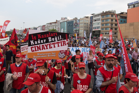 ISTANBUL, TURKEY - MAY 25, 2014: Unions march in protest against subcontractors in Turkey. Accidents at work is not fate it is murder write on banner